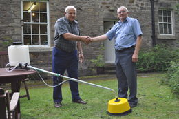 And the winner is... - Nick Stott (left) is presented his prize by Graham Thompson from Micron Group.