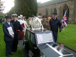 "Micron Wins at Scarecrow Festival - Wendy, Janet, Gina and Graham with ""Churchill"" outside St. Peters Church"